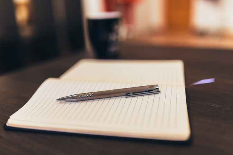 coffee notebook pen writing